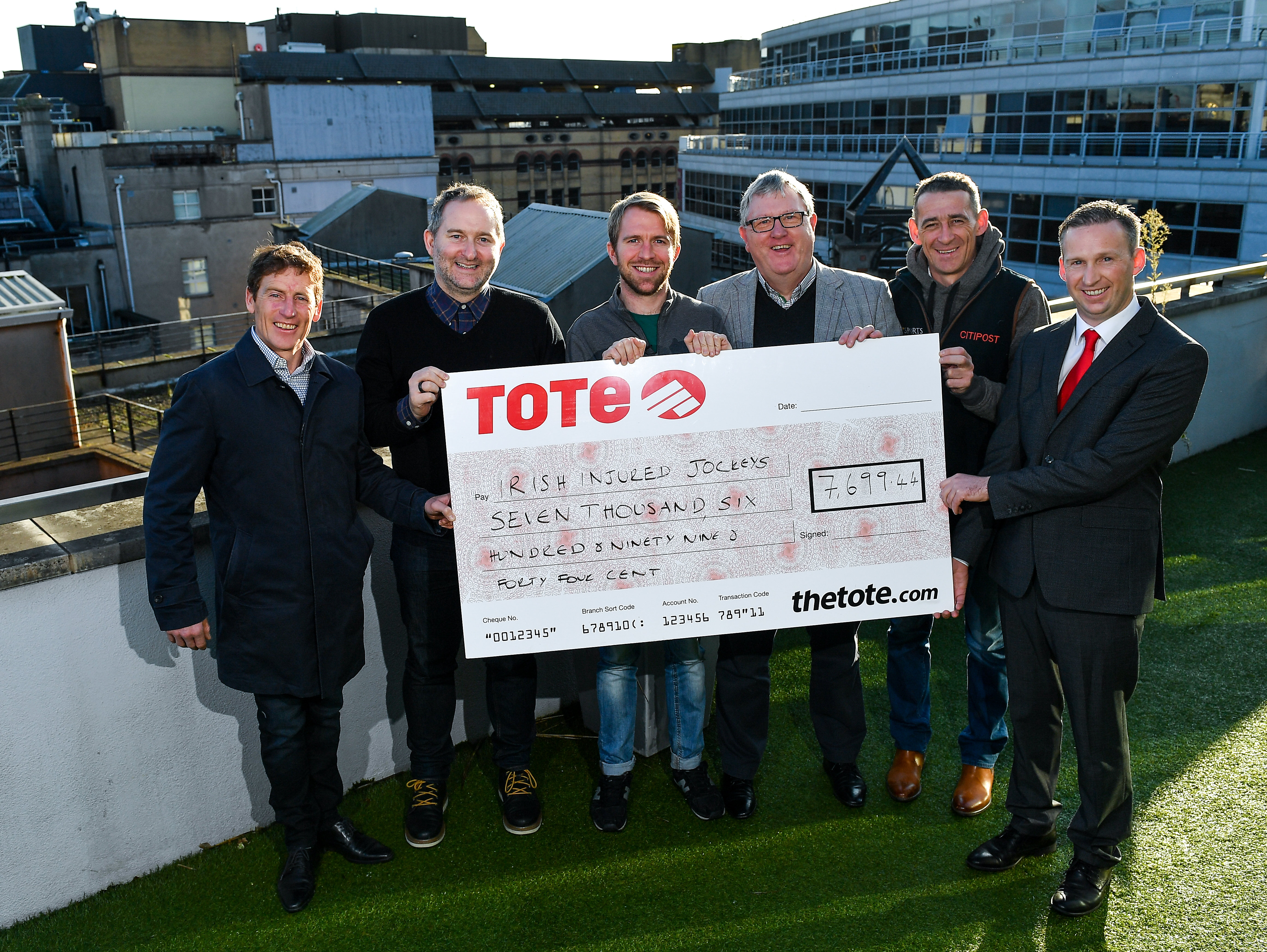 Tote and Off The Ball present €7,699 to Irish Injured Jockeys in time for Christmas