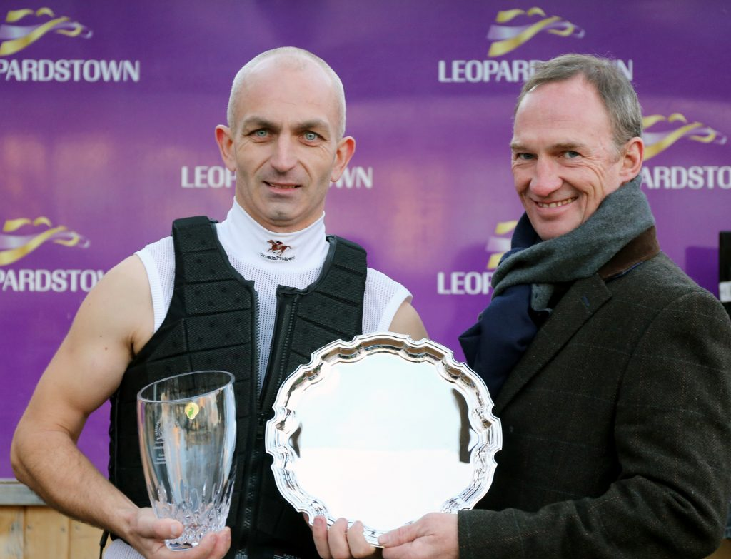 Retired Jockey, Paul Carberry presents Graham Atkinson with the winner's trophy as he is crowned the 2018 Corinthian Challenge Champion